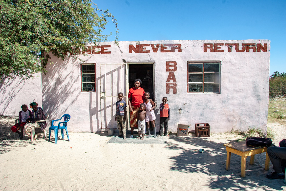 Chance Never Return Bar, with its owner and her children by the entrance. Namibia.